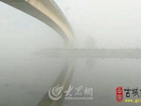 山东台儿庄:雾锁京杭大运河(图)
