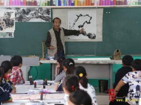 【图文】台儿庄区实验小学举行艺术家进校园活动