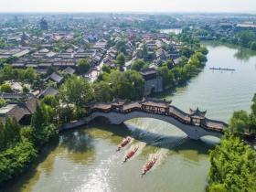 激情竞渡世界文化遗产:2019中国大运河(台儿庄)国际龙舟赛在台儿庄古城敲响战鼓